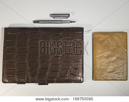 The notepads, purses and metal ballpoint pen isolated