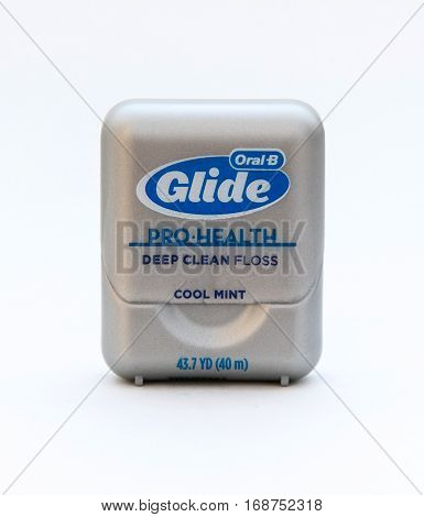 New York January 25 2017: A pack of Glide dental floss isolated on white background