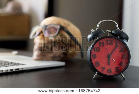 Business man dead skull working overtime concept