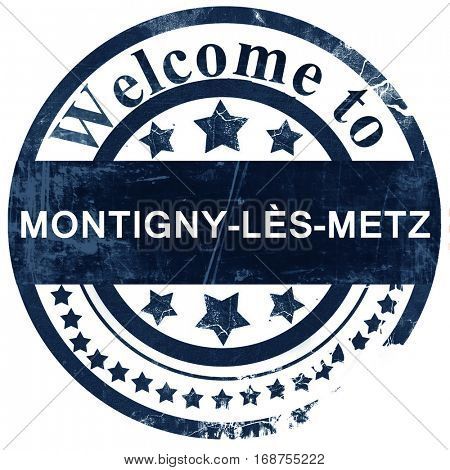 montigny-les-metz road sign, vintage green with clouds backgrou