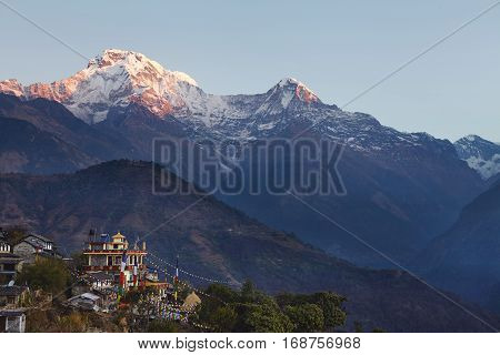 Rural Life In Front Of Gigantic Himalayas, Nepal. Incredible View Of Nepali Village With Buddhist Fl