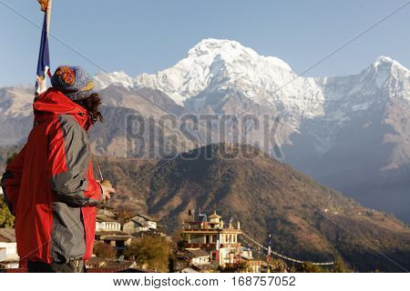 Outdoor Shot Of Unrecognizable Hiker Wearing Colorful Hat And Vest Drinking Mate And Admiring Amazin