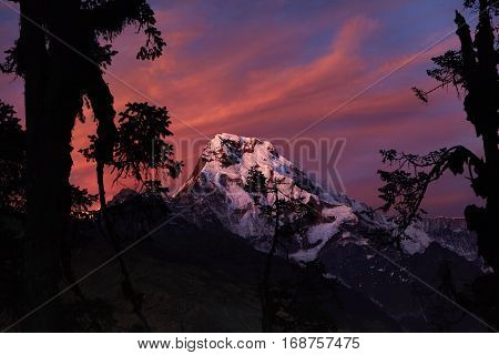 Rays Of Red Sunset On Top Of Mount Annapurna South. Spectacular Outdoor Shot Of Craggy White Summit