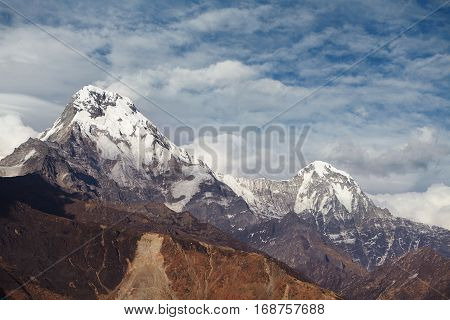 Frosty And Cloudy Winter Sky Over White Craggy Peak Of Mountain Massif. Spectacular Mountain Ridge O