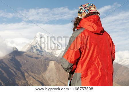 Mountaineering, Hiking, Climbing And Trekking Concept. Hiker Wearing Red Vest Standing On Top Of Cli