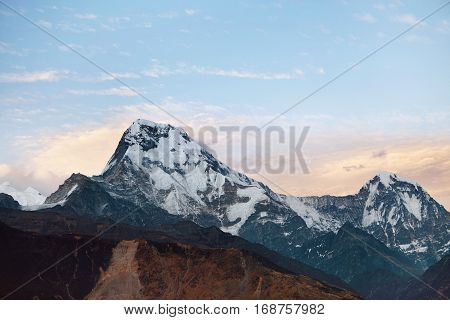 Wild Nature, Travel, Adventure, Mountaineering And Hiking Concept. Amazing Blue Sky Over White Snow