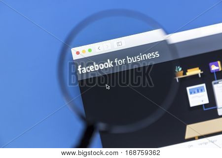 Ostersund, Sweden - January 14, 2017 Closeup of Facebook Business website under a magnifying glass. Facebook is the most visited social network in the world