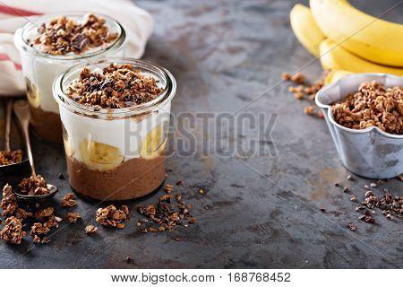 Chocolate chia pudding parfait with banana, granola and yogurt
