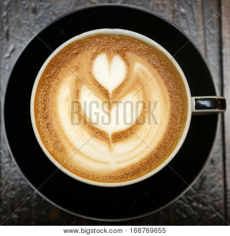Coffee with Hot Rich Latte Art in the foam on top. Coffee and Latte Coffee are the most popular beverage in the world.