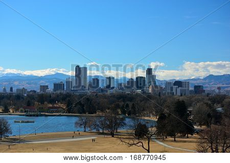 Downtown Denver Colorado Skyscrapers with the Rocky Mountains in the Background on a Sunny Winter Day