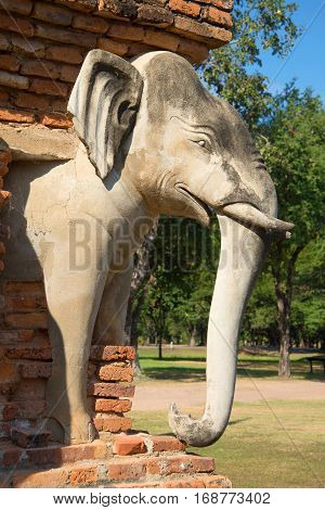 Sculpture elephant closeup supporting an ancient buddhist chedi Wat Sorasak. Historical Park of Sukhothai, Thailand