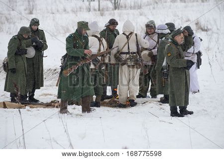 LENINGRAD REGION, RUSSIA - JANUARY 15, 2017: Members of military-historical reconstruction in the form of Wehrmacht soldiers before the battle. A fragment of the festival in honor of the lifting of the blockade of Leningrad
