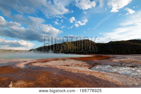 Grand Prismatic Hot Spring under sunset clouds in the Midway Geyser Basin in Yellowstone