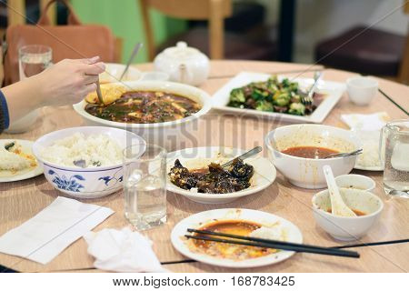 People Eating Szechuan Chinese Food