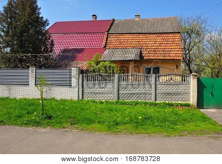 Old house is being renovated and refurbished with metal roof asbestos and ceramic tiles.