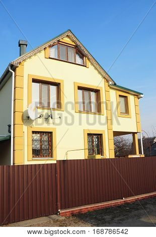 New House with Colorful Facade Exterior. Close up.