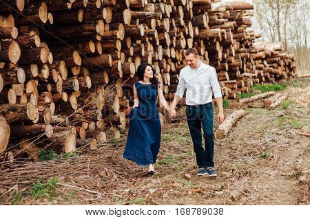 Happy Couple In Love Walking Past The Logs
