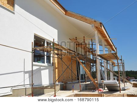 Home Remodeling and Renovation. Construction or Repair of the Rural House with Skylights Eaves Windows Fixing Facade Insulation Plastering and Painting House Facade Wall. Install Plastic Siding Soffits and Eaves Exterior.