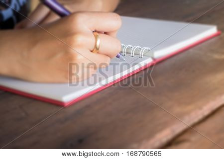 Noteboook paper on wood background stock photo