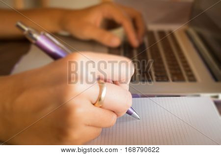 Opened laptop on wooden work table stock photo