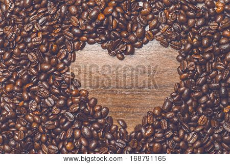 Coffe beans on the table in the morning with hearth shape inside