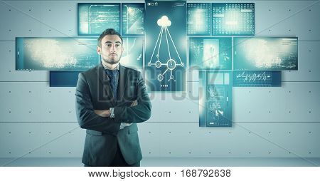 Young bussinessman in front of multi touch screens.