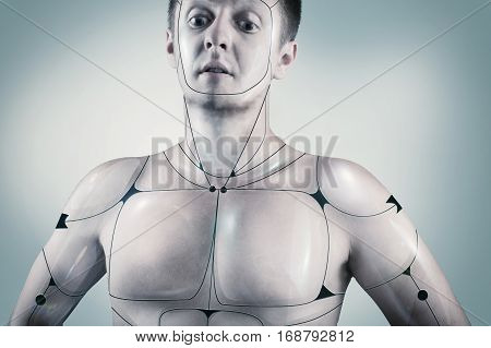 Portrait of a cyborg male in a blue background.