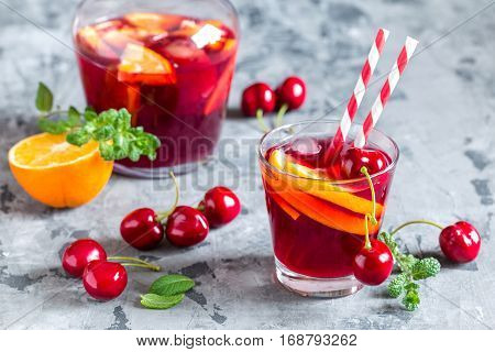 Summer cool alcoholic drink sangria with fresh fruits and berries