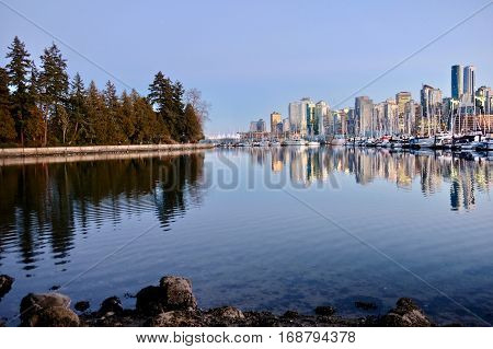 Vancouver skyline and Stanley Park seawall. Coal Harbor. West End. Vancouver downtown. British Columbia. Canada.