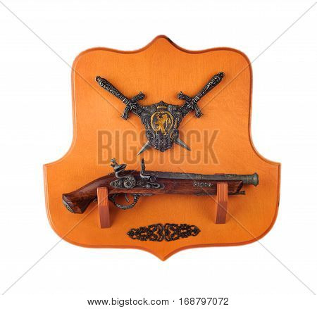 miniature pistol daggers and coat of arms on a wooden stand