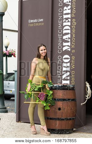 FUNCHAL MADEIRA PORUGAL - SEPTEMBER 3 2016: Wine producers encourage to the tasting of their wines during Madeira wine Festival in Funchal on Madeira Portugal
