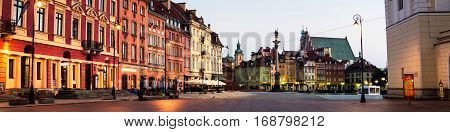 Early morning in Warsaw Poland at the empty Palace square. Illuminated historical buildings.