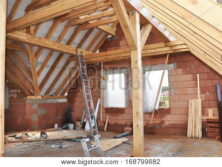 Attic Construction. Building Attic Interior. Roofing Construction Indoor. Wooden Roof Frame Attic House Construction.