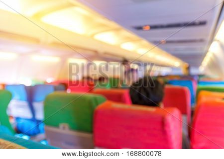 Blur Of Airplane Seat With In Cabin Of Huge Aircraft