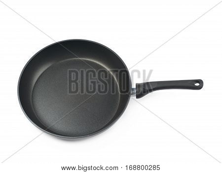 Metal black frying pan with a non-stick coating, composition isolated over the white background