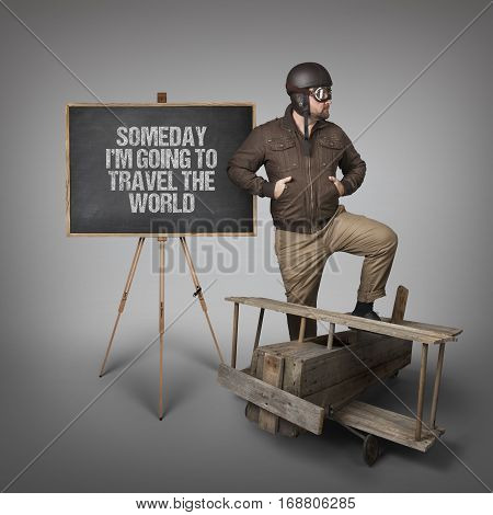 Someday Im going to travel the world text on blackboard with businessman pilot outfit