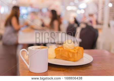 Hot Coffee With Toast In Cafe Shop