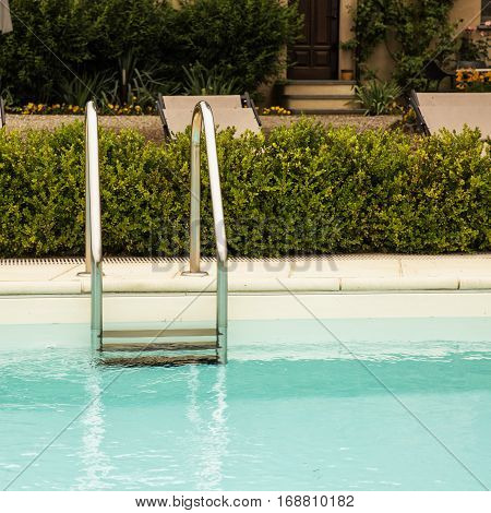 Pool ladder in a garden square image