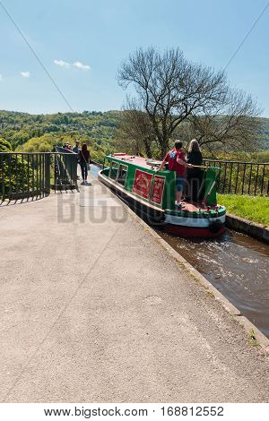 TREVOR WALES UNITED KINGDOM - MAY 16 2016: Narrowboat crossing the Pontcysyllte aqueduct constructed in 1805 it is the longest and highest aqueduct in the UK and a World Heritage Site
