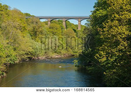The River Dee or Afon Dyfrdwy with the Pontcysyllte canal aqueduct in North Wales constructed in 1805 a World Heritage Site and popular tourist location