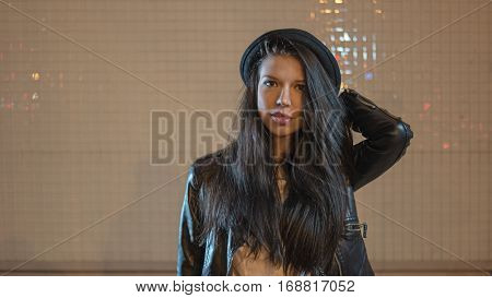 Young woman in black hat front view looking at camera, a lot of space for text retro color shot, colorized image, selective focus.