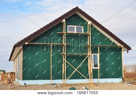 KIEV UKRAINE - JANUARY 8 2017: Building New House with Plastic Siding and Insulation Membrane on House Wall.