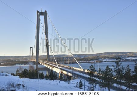 High coast bridge in midwinter sun picture from the North of Sweden.