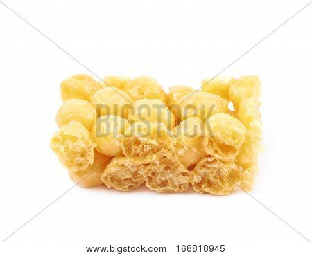 Cornflake balls caramel candy isolated over the white background