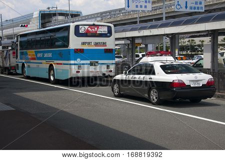 Osaka, Japan - Aug 10: Airport Limousine Bus And Police Car In Osaka International Airport Itami. Au