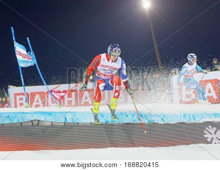 STOCKHOLM SWEDEN - JAN 31 2017: Dave Ryding (GBR) and competitor jumping in the downhill skiing in the parallel slalom alpine event Audi FIS Ski World Cup. January 31 2017 Stockholm Sweden