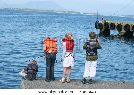 group of children fishing in the port