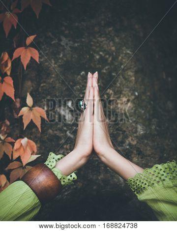 woman doing yoga outdoor closeup of hands