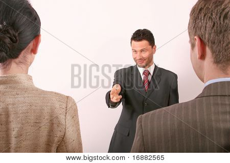 handsome business man pointing at woman