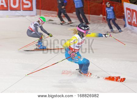 STOCKHOLM SWEDEN - JAN 31 2017: Side view of Frida Hansdotter (SWE) and competitor in the parallel slalom downhill skiing at the Alpine Audi FIS Ski World Cup - city event January 31 2017 Stockholm Sweden